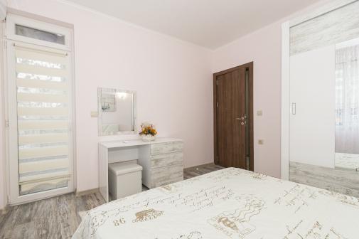 Спалня във ваканционен апартамент в Сарафово Бургас